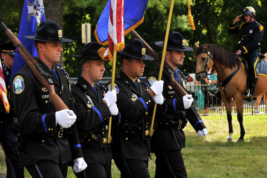 Newtown Police Officers from left William Chapman, Matthew Hayes, Richard Monckton and Ben Muhall process into St. Philip Church in Norwalk, Conn., for Blue Mass honoring first responders on Sunday, Sept. 15, 2013. Photo: Jason Rearick / Stamford Advocate