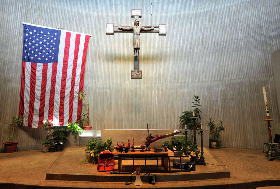 The tools of first responders are displayed at the alter before the start of Blue Mass honoring first responders at St. Philip Church in Norwalk, Conn., on Sunday, Sept. 15, 2013. Photo: Jason Rearick / Stamford Advocate
