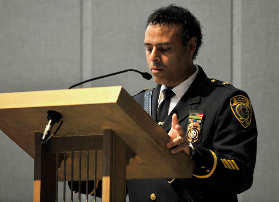 Lt. James Perez from the Fairfield Police Department gives the first reading during Blue Mass honoring first responders at St. Philip Church in Norwalk, Conn., on Sunday, Sept. 15, 2013. Photo: Jason Rearick / Stamford Advocate