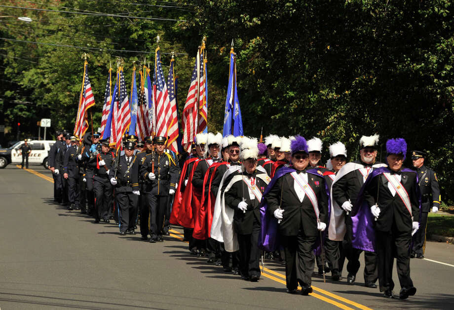 Members of the Knights of Columbus lead a contingent of first responders along France Street in Norwalk, Conn., prior to the start of Blue Mass honoring first responders at St. Philip Church in Norwalk, Conn., on Sunday, Sept. 15, 2013. Photo: Jason Rearick / Stamford Advocate