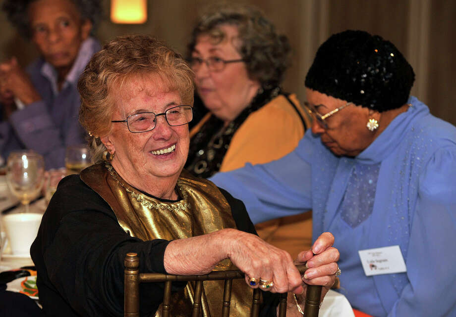 Hellen Mollo-DeLuca smiles as she listens to her classmate speak during the Class of 1943's 70-year reunion at Giovanni's II Water's Edge restaurant in Darien on Sunday, Sept. 15, 2013. Photo: Jason Rearick / Stamford Advocate