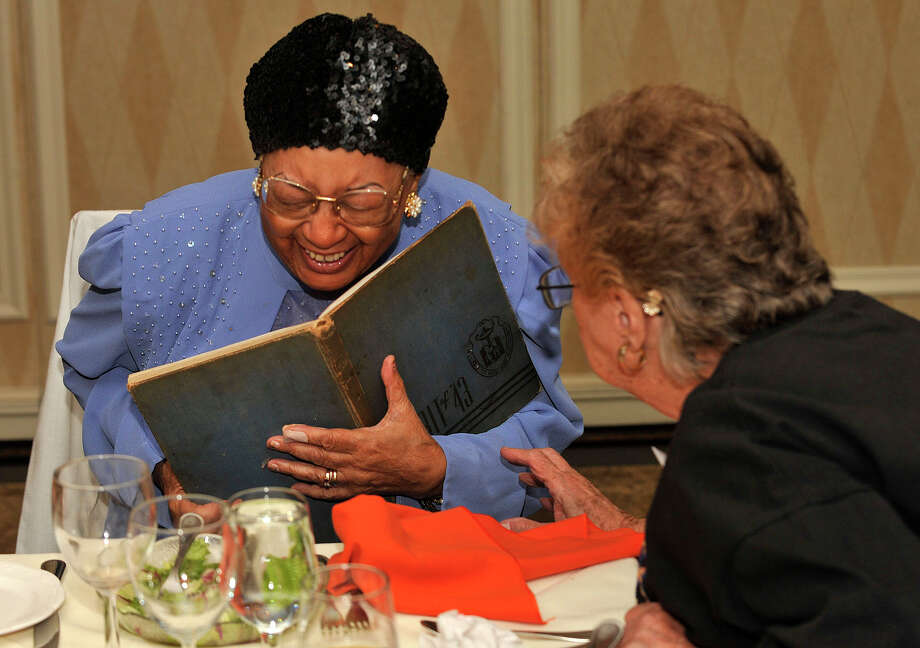 Lula Ingram-Blackson, left, and Hellen Mollo-DeLuca share a laugh while looking at a yearbook during the Class of 1943's 70-year reunion at Giovanni's II Water's Edge restaurant in Darien on Sunday, Sept. 15, 2013. Photo: Jason Rearick / Stamford Advocate