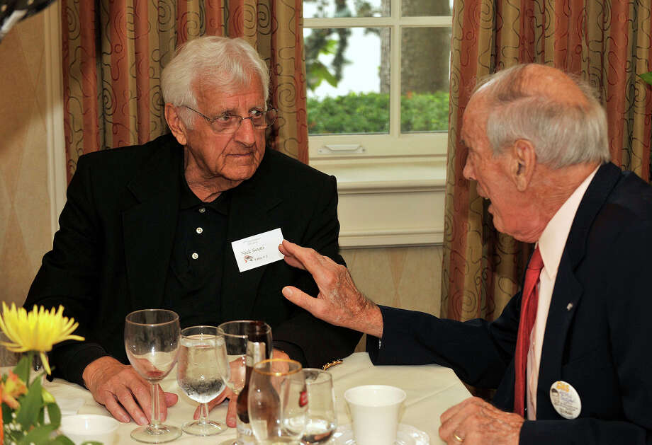 Nick Scutti, left, and Fred Giuliani chat during the Class of 1943's 70-year reunion at Giovanni's II Water's Edge restaurant in Darien on Sunday, Sept. 15, 2013. Photo: Jason Rearick / Stamford Advocate