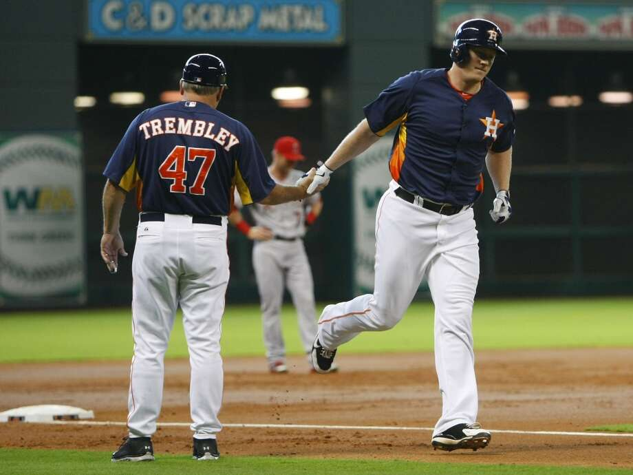 Astros third base coach Dave Trembley greets Marc Krauss after he hit a home run during the second inning. Photo: Cody Duty, Chronicle