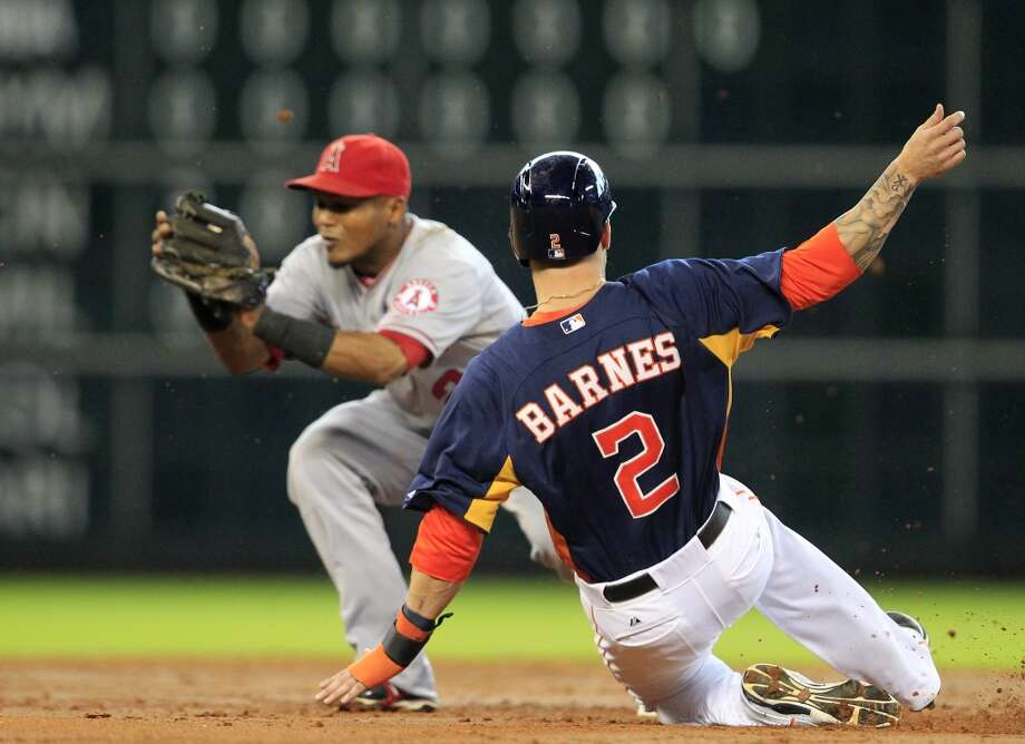 Brandon Barnes slides unsafely into second base as Angels shortstop Erick Aybar prepares to make the tag. Photo: Cody Duty, Chronicle