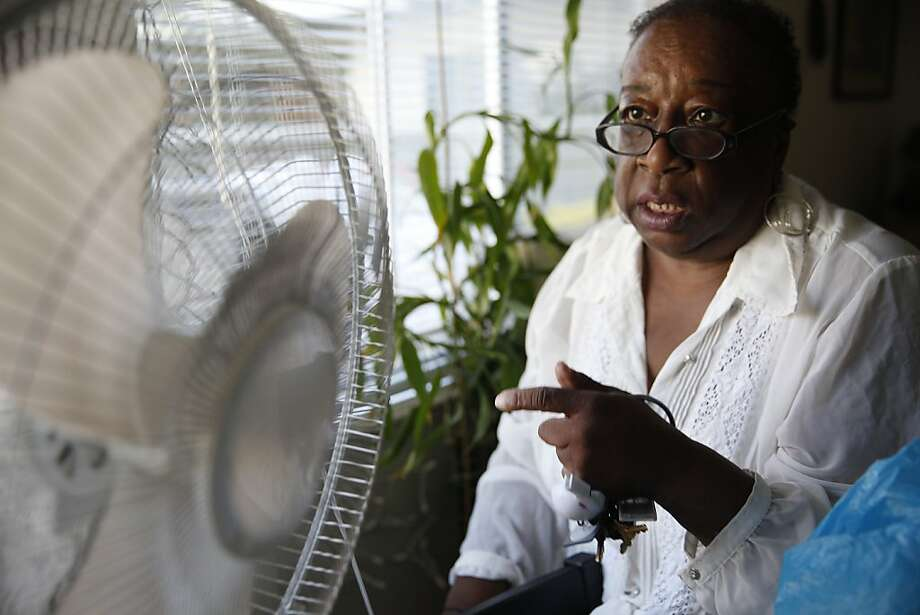 Margaret Gordon, co-director of the West Oakland Environmental Indicators Project, points to soot on a fan at her home. Photo: Lea Suzuki, The Chronicle