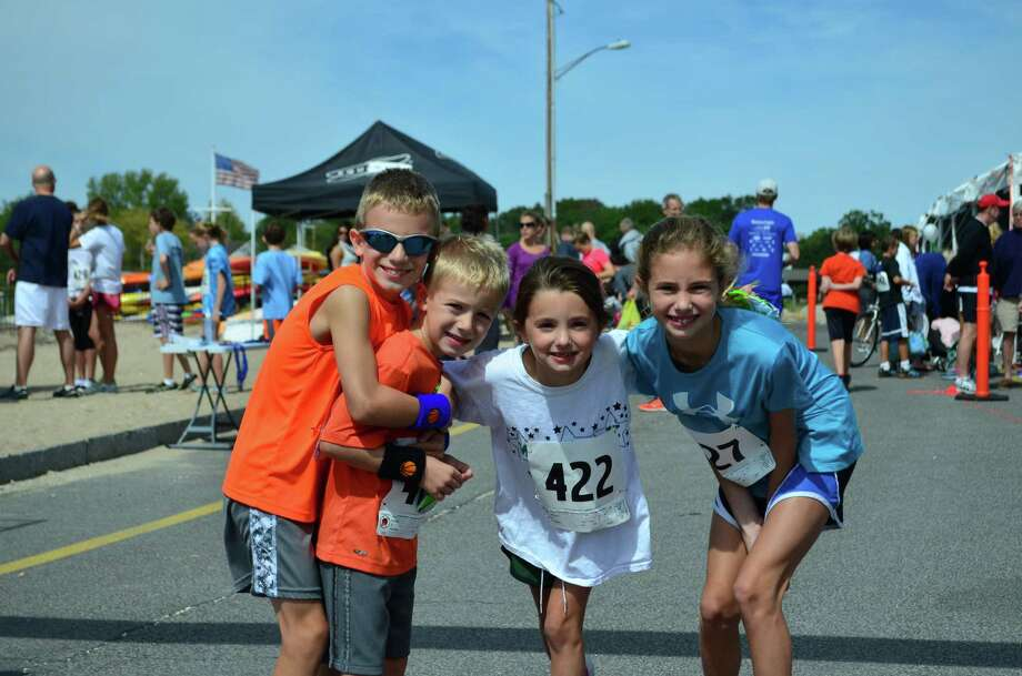 Lance Anavy, from left, Evan Anavy, Erin Luecke and Kendall Lueke all took part int he Darien Road Race on Sunday, Sept. 15 at Pear Tree Point Beach in Darien, Conn. Photo: Megan Spicer
