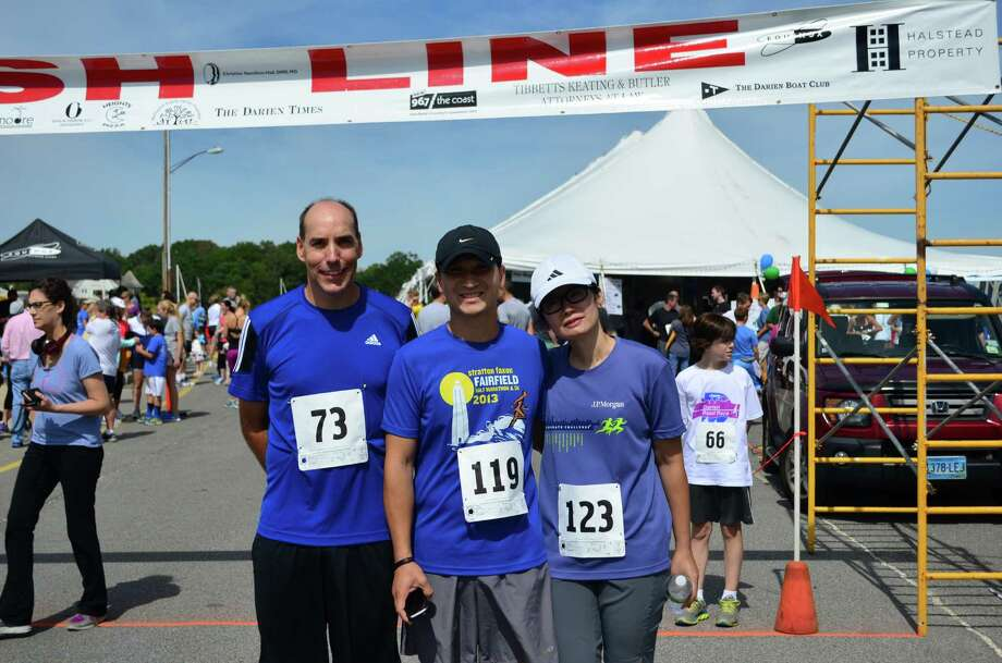Scott Gallagher, from left, Shu Lee and Yee Liu before the Darien Road Race at Pear Tree Point Beach on Sunday, Sept. 15 in Darien, Conn. Photo: Megan Spicer
