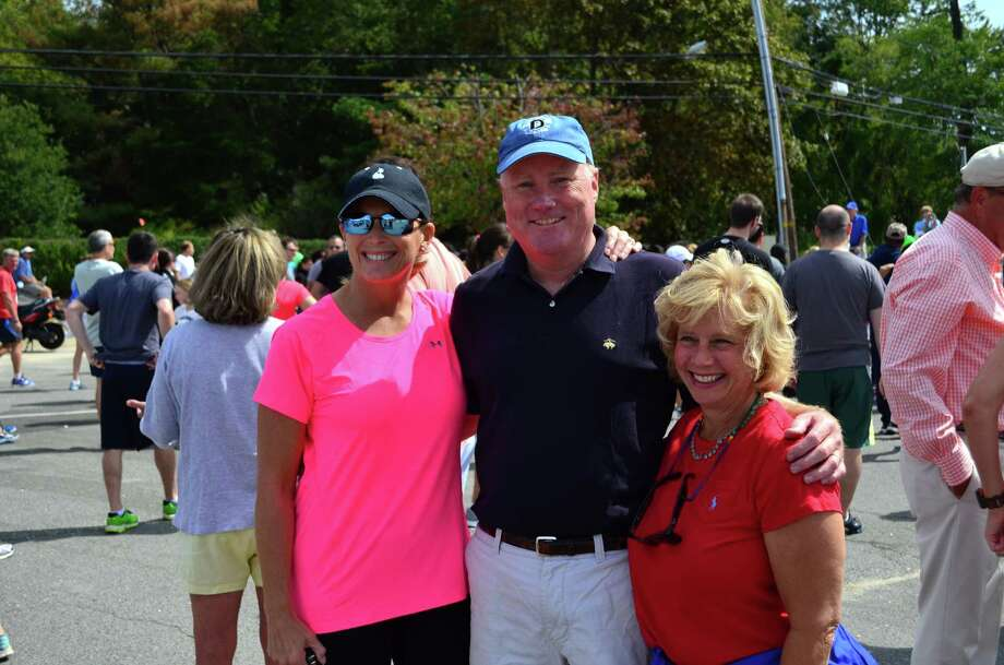 "First Selectman Jayme Stevenson, Selectman Jerry Nielsen and Susan Marks before the Darien Road Race on Sunday, Sept. 15 in Darien, Conn. Stevenson ran in the 1.5-mile ""fun run."" Photo: Megan Spicer"
