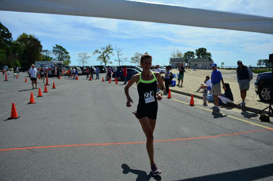 Mary Zengo, of Wilton, was the first woman to complete the 10K race. She won for the women's overall in 2012, as well. The Darien Road Race took place on Sept. 15 in Darien, Conn. Photo: Megan Spicer