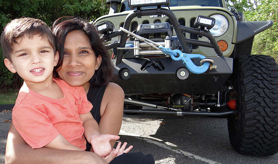 Heena Heffer, with son Adam, at the Junior Women's Club Touch-A-Truck event Sunday at Fairfield Ludlowe High School. Photo: Mike Lauterborn / Fairfield Citizen contributed