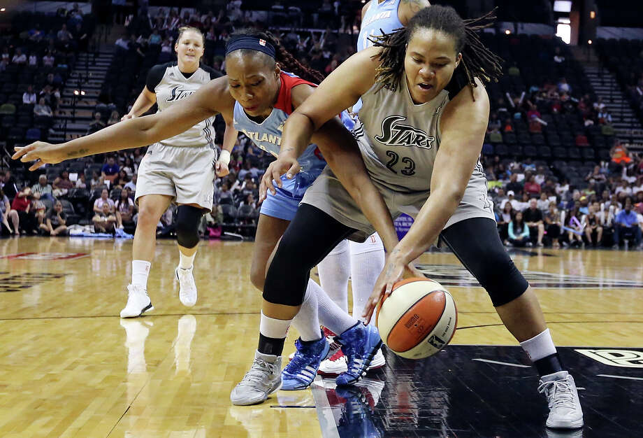 Silver Stars' Danielle Adams grabs for a loose ball against the Dream's Le'Coe Willingham during first half action Sunday Sept. 15, 2013 at the AT&T Center. Photo: Edward A. Ornelas, San Antonio Express-News / © 2012 San Antonio Express-News