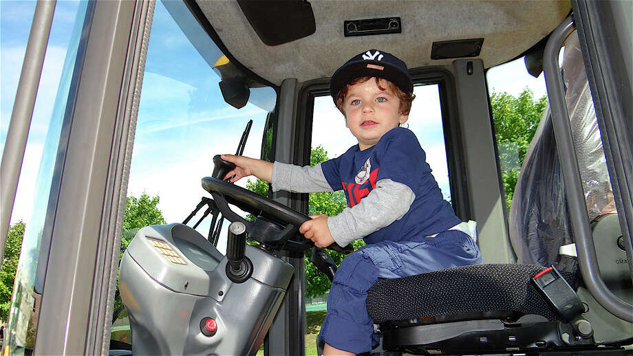 Gavin Vendig, 2, Fairfield, in the Southport Volunteer Fire Department's Squad 14 truck Sunday at Touch-A-Truck. Photo: Mike Lauterborn / Fairfield Citizen contributed