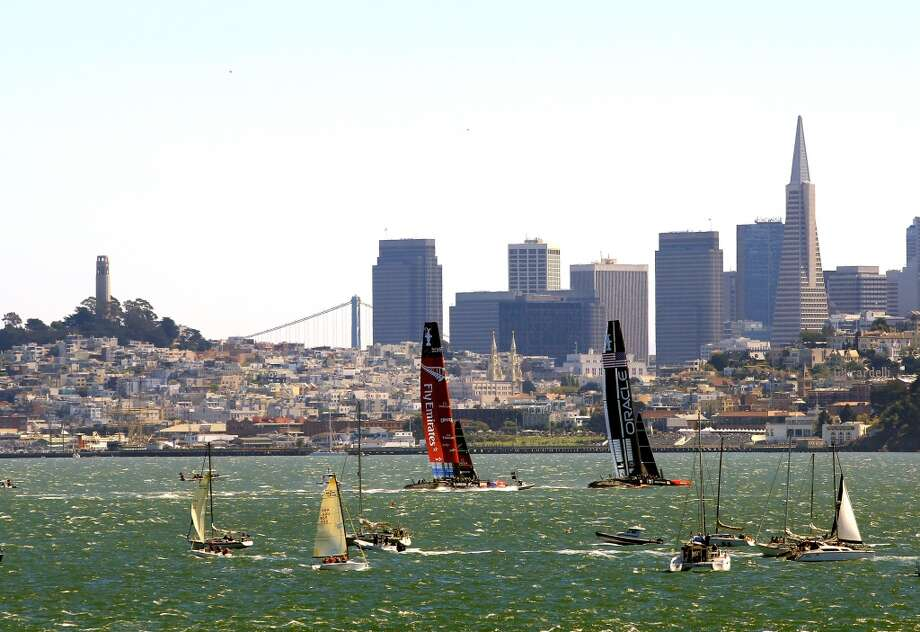 Emirates Team New Zealand and Oracle Team USA race in front of the San Francisco Skyline during race 9 of the America's Cup finals on September 15, 2013 in San Francisco, California. Photo: Jamie Squire, Getty Images