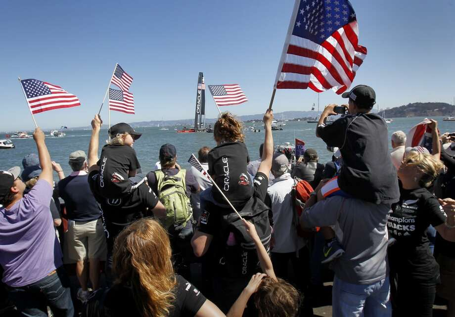 Fans of the Oracle team cheered on the Americans as they sailed out to begin the first race Sunday September 15, 2013 in San Francisco, Calif. At the America's Cup park at Pier 27, hundreds of sailing fans watched the action between the United States and New Zealand. Photo: Brant Ward, The Chronicle