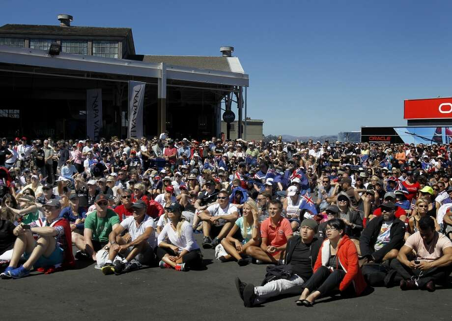 An overflow crowd sat and watched a giant television broadcast of the first race Sunday September 15, 2013 in San Francisco, Calif. At the America's Cup park at Pier 27, hundreds of sailing fans watched the action between the United States and New Zealand. The Oracle team won the first race. Photo: Brant Ward, The Chronicle