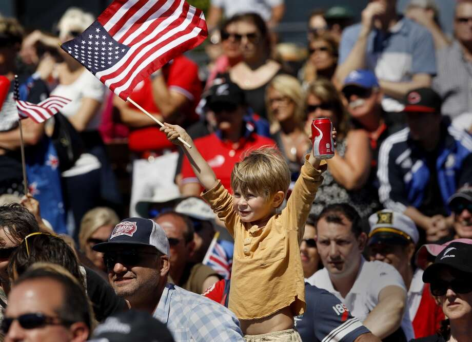 Jonah Braud, 4 years, of Petaluma celebrated an early lead for the American catamaran in the first race Sunday September 15, 2013. At the America's Cup park at Pier 27, hundreds of sailing fans watched the action between the United States and New Zealand. The Oracle team won the first race. Photo: Brant Ward, The Chronicle