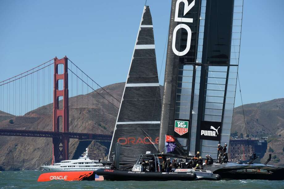 Oracle Team USA sails past the Golden Gate Bridge as it competes against Emirates Team New Zealand during the 34th America's Cup on September 15, 2013 in San Francisco. Photo: DON EMMERT, AFP/Getty Images