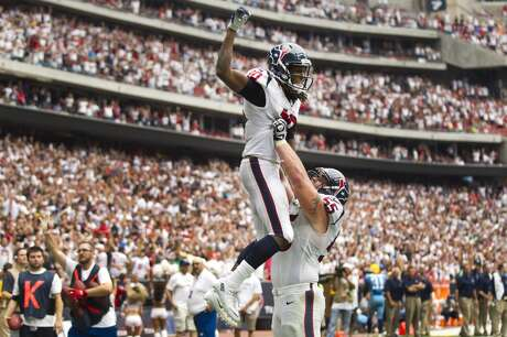 Texans offensive lineman lifts receiver DeAndre Hopkins after the game-winning touchdown against the Titans.