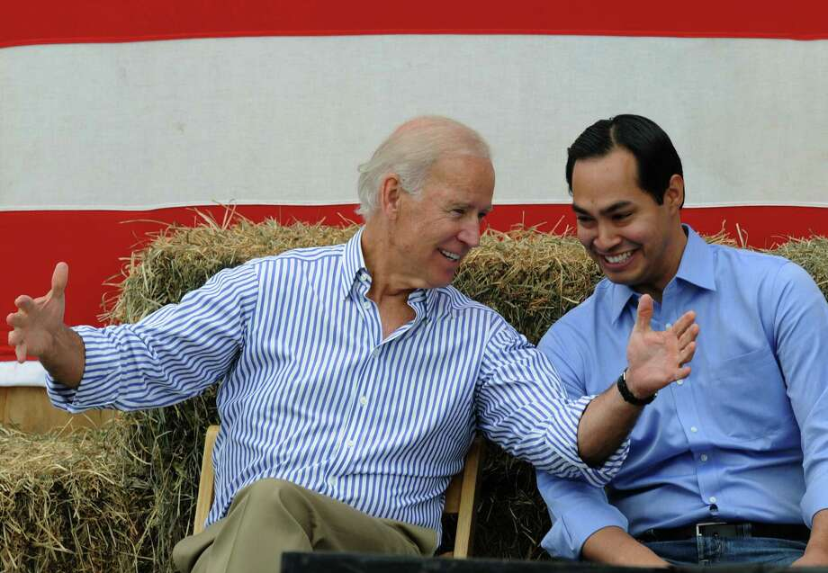 Vice President Joe Biden (R) and San Antonio Mayor Julian Castro share a moment onstage at the 36th Annual Harkin Steak Fry on September 15, 2013 in Indianola, Iowa. Sen. Harkin's Democratic fundraiser is one of the largest in Iowa each year. Photo: Steve Pope, Getty Images / 2013 Getty Images