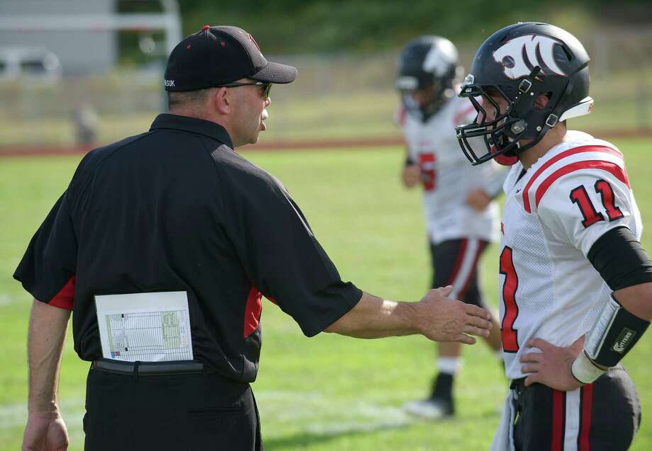 Masuk head coach Dave Brennan talks with Zach Kaufman, 11, during Sunday's boys football game between Masuk and New Milford High School's in New Milford, September 15, 2013. Photo: H John Voorhees III