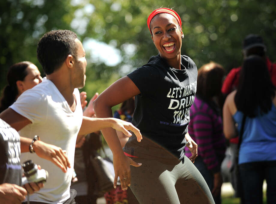 Cedric Leiba, Jr., left, and Milteri Tucker, members of the Bombazo Dance Company from New York City, dance to the music of Bridgeport-based salsa band Afinke, at the first annual Stratford Latin Music Festival on Paradise Green in Stratford, Conn. on Sunday, September 15, 2013. Photo: Brian A. Pounds / Connecticut Post