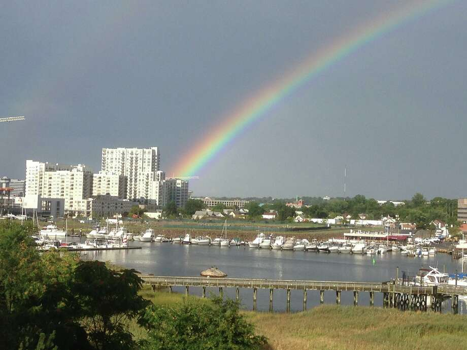 A rainbow forms over Stamford Harbor on Friday, Sept. 13, 2013. Photo: Alan Steen/Contributed