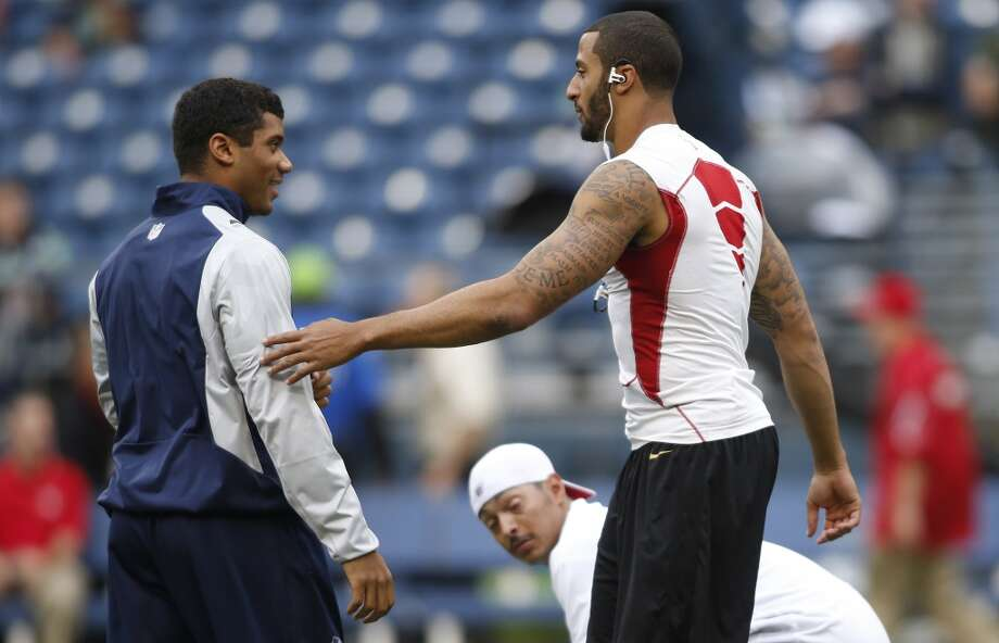 Seattle Seahawks quarterback Russell Wilson, left, greets San Francisco 49ers quarterback Colin Kaepernick, right, on the field prior to the game. Photo: John Froschauer, Associated Press
