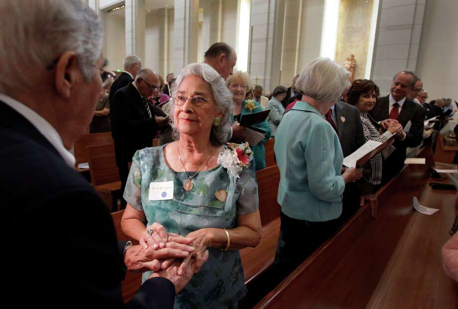 Jesus Reyna, left, and his wife, Margarita Reyna of South Houston participate in the Blessing of the Rings during the Wedding Anniversary Jubilee at the Co-Cathedral of the Sacred Heart, 1111 St. Joseph Pkwy., Sunday, Sept. 15, 2013, in Houston. The Reyna's joined more than 250 other couples in a mass lead by Cardinal Daniel DiNardo honoring couples celebrating their 50th wedding anniversary. Photo: Melissa Phillip, Houston Chronicle / © 2013  Houston Chronicle