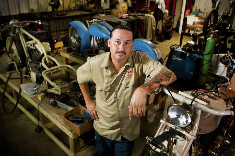 Danny Sanchez, who builds custom motorcycles, poses for a portrait at Cutthroat Customs Thursday, Sept. 12, 2013, in Humble. Sanchez is one of 20 people from across the country Sanchez has been invited to show a piece at the prestigious Artistry in Iron show at the Las Vegas Bike Fest in October. Photo: Brett Coomer, Houston Chronicle / © 2013 Houston Chronicle