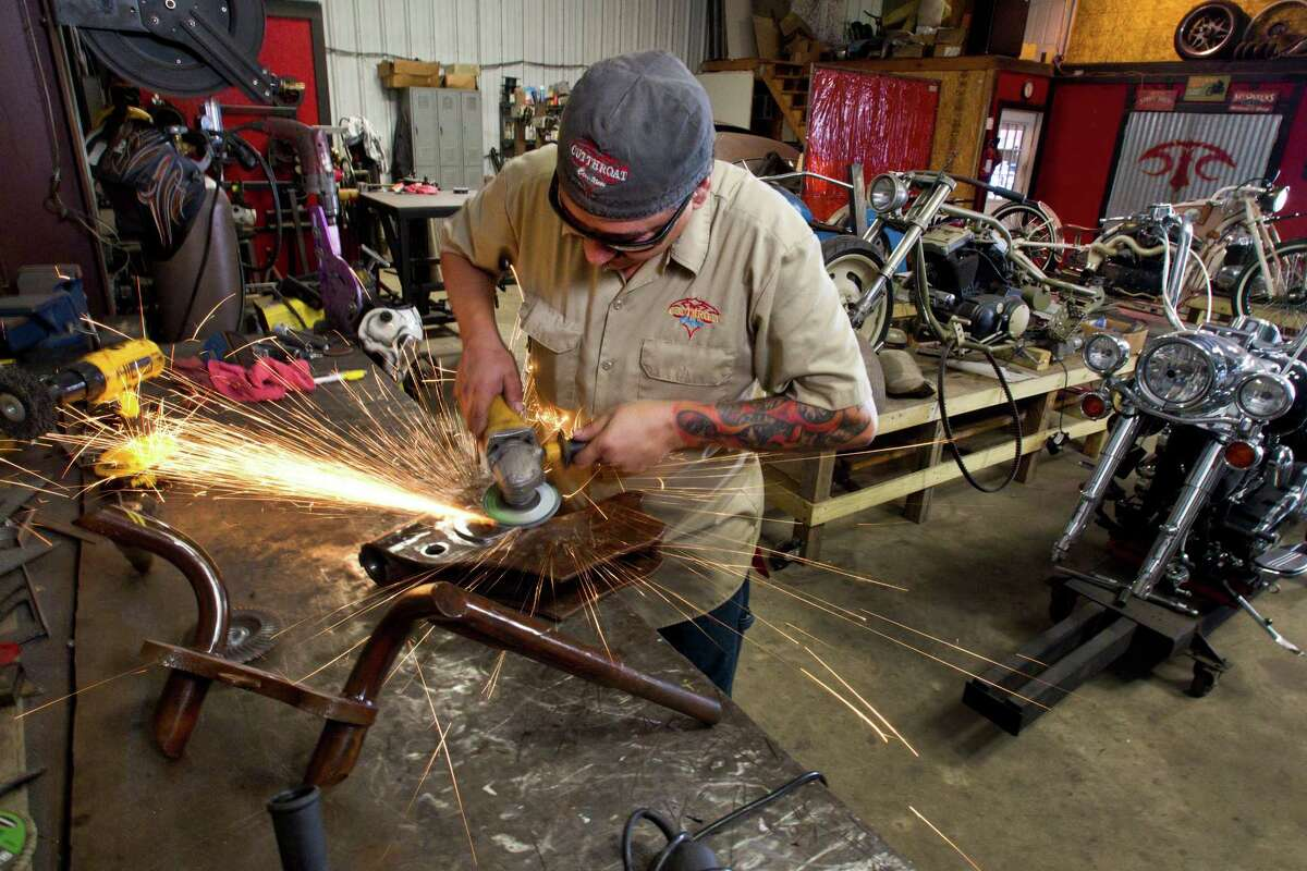 Danny Sanchez, who builds custom motorcycles, works in the shop at Cutthroat Customs Thursday, Sept. 12, 2013, in Humble. Sanchez is one of 20 people from across the country Sanchez has been invited to show a piece at the prestigious Artistry in Iron show at the Las Vegas Bike Fest in October.