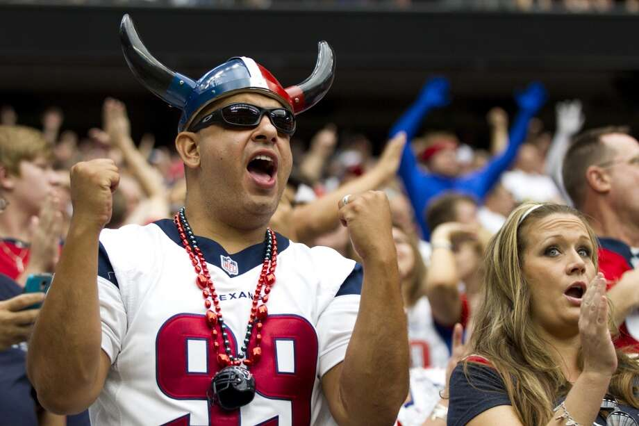 Fans cheer during the fourth quarter. Photo: Brett Coomer, Chronicle