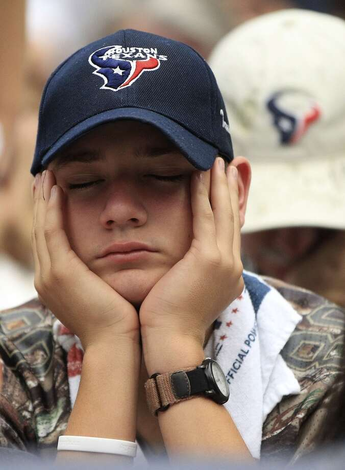 Garren Picket, 14, of San Antonio reacts after a Titans touchdown during the fourth quarter. Photo: Karen Warren, Chronicle