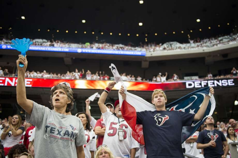 Fans cheer their defense during the second half. Photo: Smiley N. Pool, Chronicle