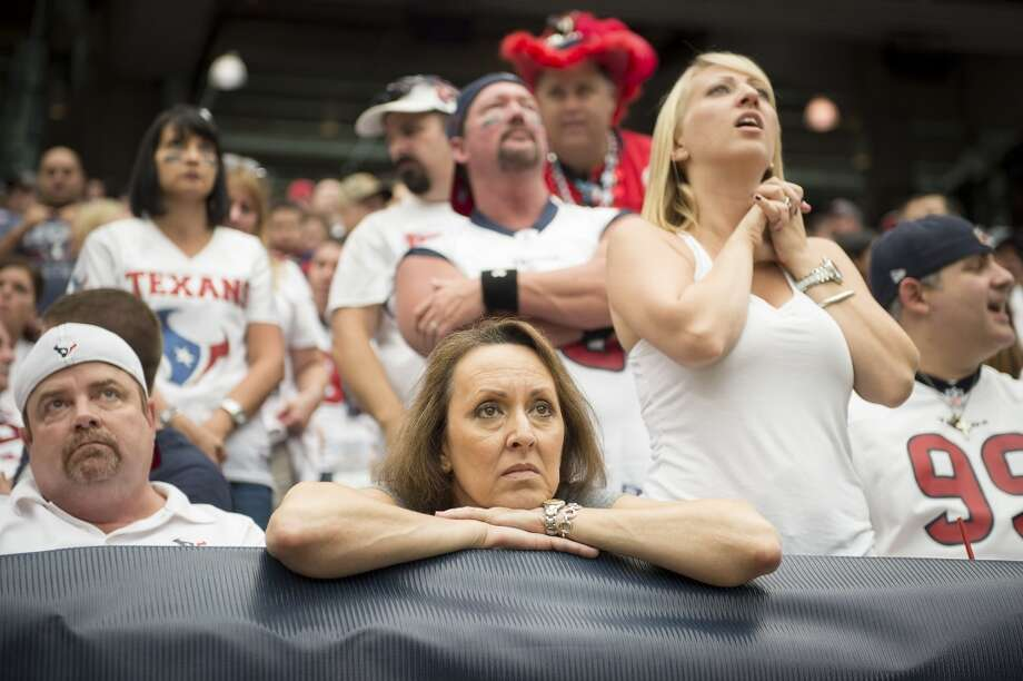 Nervous Texans fans watch their team during overtime. Photo: Smiley N. Pool, Chronicle