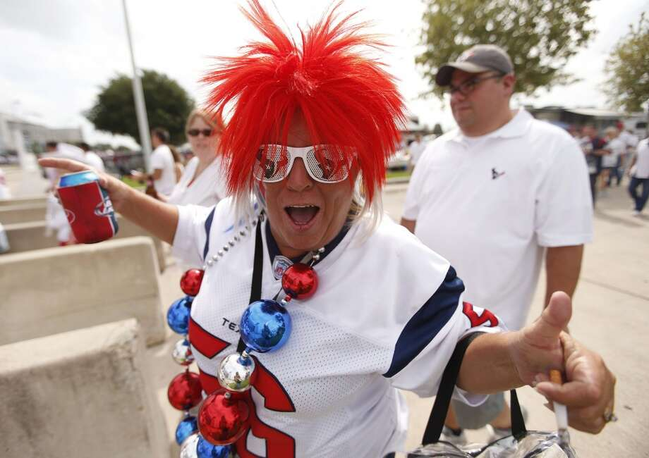 Sandra White gets pumped up as she walks into the stadium from the blue tailgate lot. Photo: Karen Warren, Chronicle