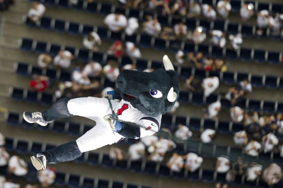 Texans mascot Toro rappels from the top of the stadium before the Texans home opener. Photo: Brett Coomer, Chronicle