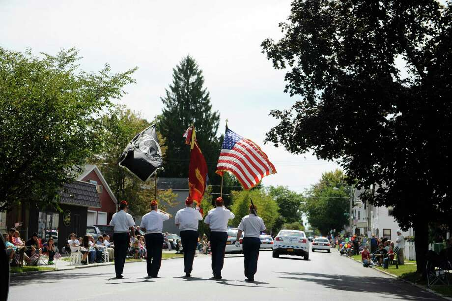 A color guard marches down 5th Avenue during the Uncle Sam Parade on Sunday, Sept. 15, 2013 in Troy, NY.   (Paul Buckowski / Times Union) Photo: Paul Buckowski / 00023875A