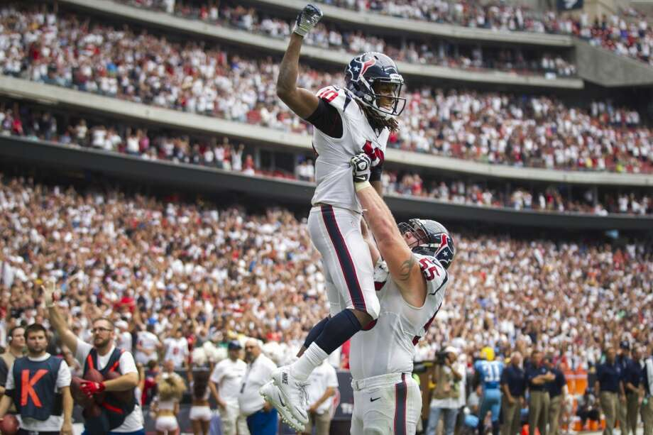 Week 2: Texans 30, Titans 24  Texans wide receiver DeAndre Hopkins and  center Chris Myers celebrate Hopkins' 3-yard touchdown reception during overtime to beat the Titans. Photo: Brett Coomer, Houston Chronicle