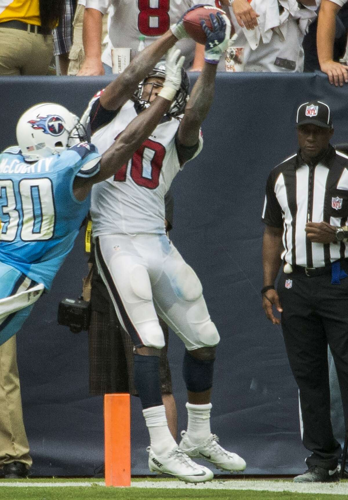 Texans wide receiver DeAndre Hopkins catches a game-winning 3-yard touchdown pass as Titans cornerback Jason McCourty defends during overtime.