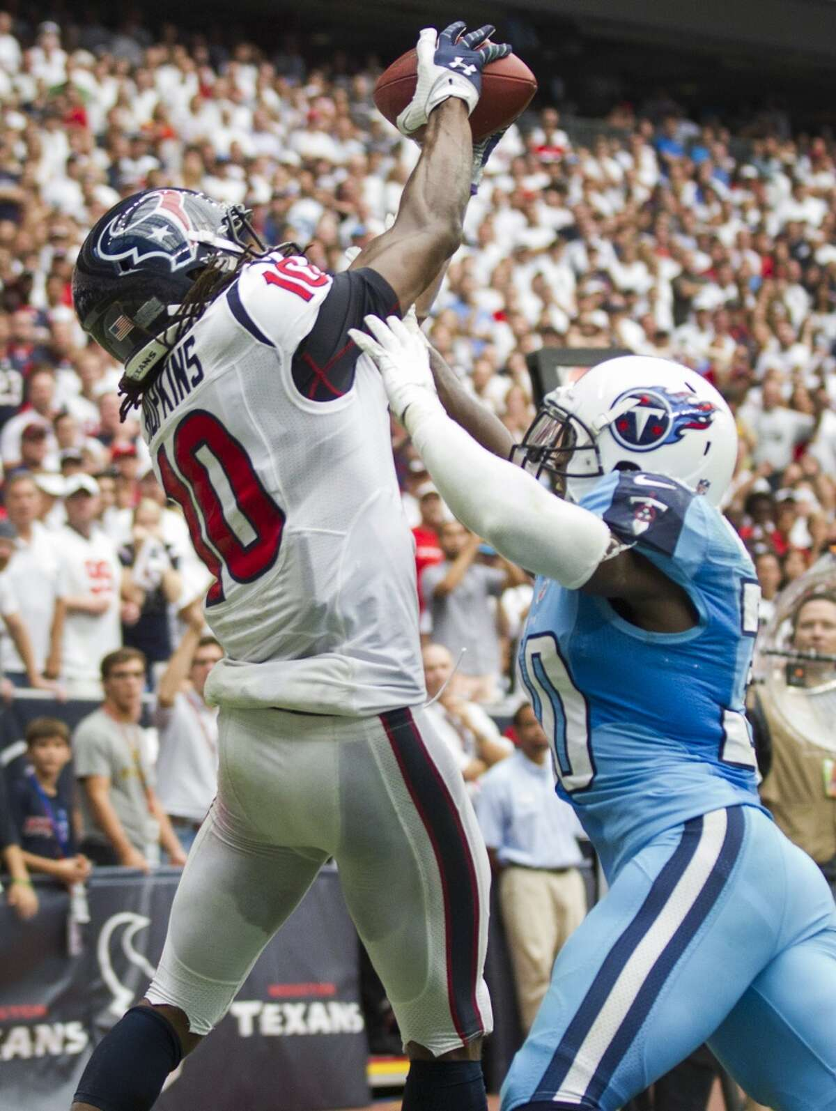 Texans wide receiver DeAndre Hopkins leaps over Titans cornerback Jason McCourty or a 3-yard touchdown reception during overtime.