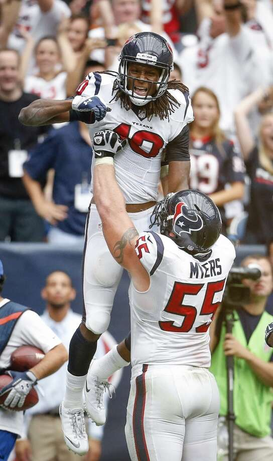 Texans wide receiver DeAndre Hopkins is lifted up after his game-winning touchdown by Chris Myers, Photo: Karen Warren, Houston Chronicle
