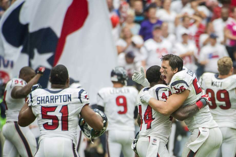 Texans inside linebacker Brian Cushing (56) celebrates with running back Ben Tate (44) after a replay review upheld a game-winning touchdown catch by wide receiver DeAndre Hopkins. Photo: Smiley N. Pool, Houston Chronicle