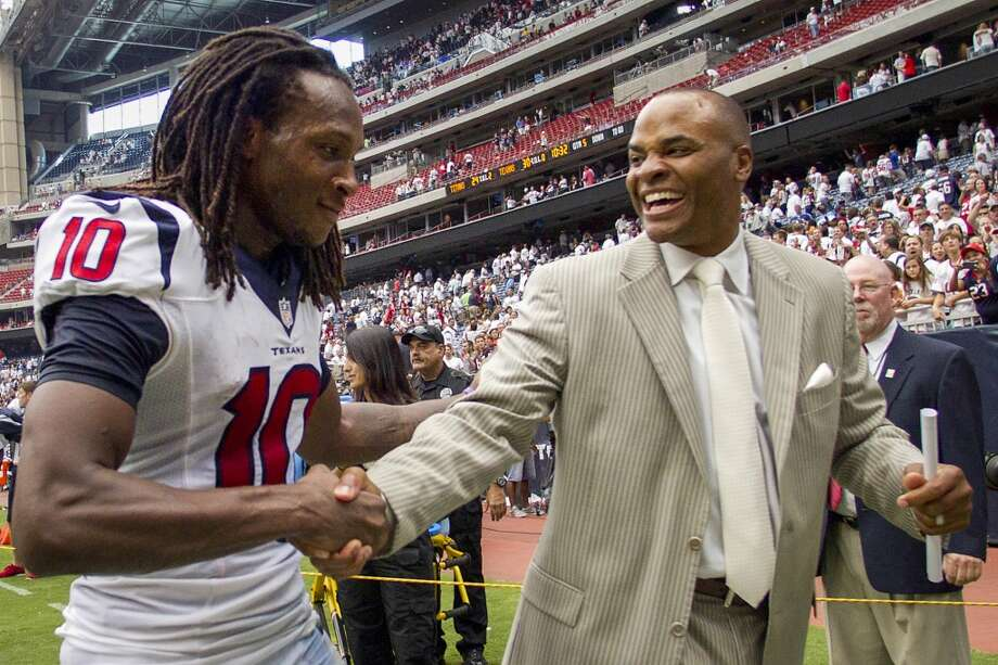 Texans wide receiver DeAndre Hopkins and  general manager Rick Smith celebrate Hopkins' touchdown reception during overtime to beat the Titans. Photo: Brett Coomer, Houston Chronicle