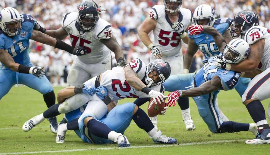 Texans running back Arian Foster stretches the ball across the goal line for a two-point conversion to tie the game during the fourth quarter. Photo: Brett Coomer, Houston Chronicle