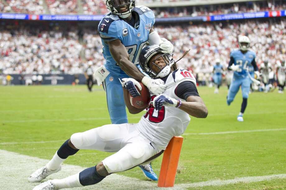 Texans wide receiver DeAndre Hopkins is stopped at the goal one by Titans cornerback Jason McCourty during overtime. Photo: Brett Coomer, Houston Chronicle