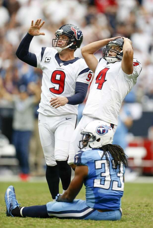 Texans kicker Randy Bullock (4) and punter Shane Lechler (9) react as Bullock's field goal attempt failed at the end of the fourth quarter. Photo: Karen Warren, Houston Chronicle
