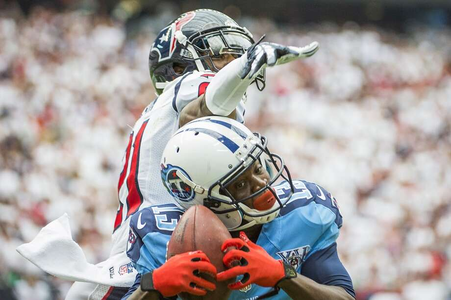Titans wide receiver Kendall Wright beats Texans cornerback Brice McCain on a 6-yard touchdown reception during the first half. Photo: Smiley N. Pool, Houston Chronicle