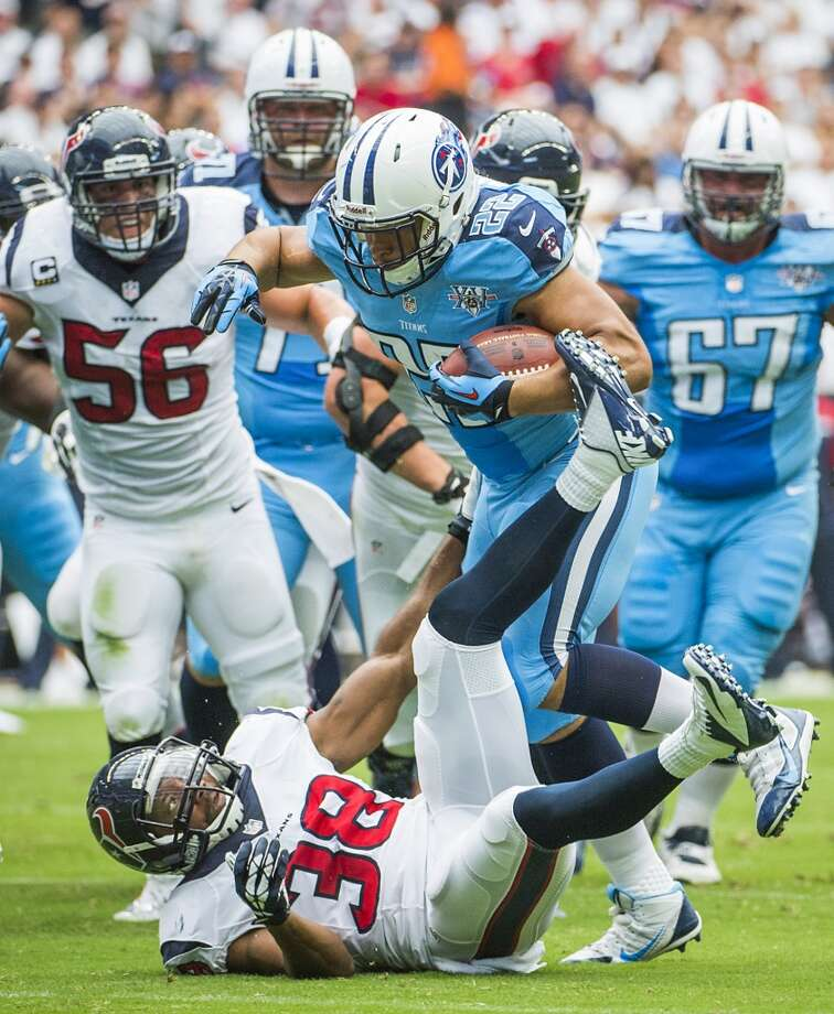 Titans running back Jackie Battle runs over Texans free safety Danieal Manning (38) during the first half. Photo: Smiley N. Pool, Houston Chronicle