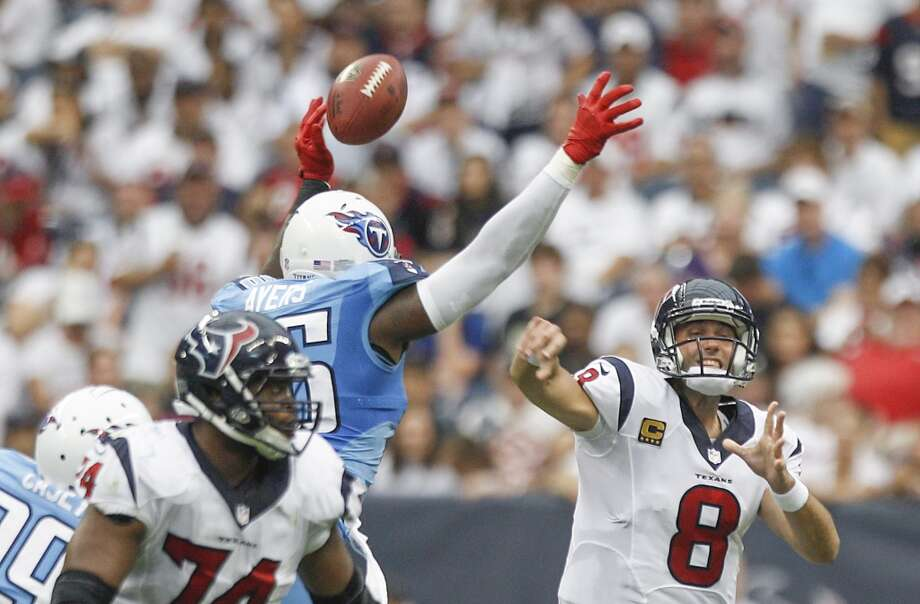 Titans linebacker Akeem Ayers knocks down a pass by Texans quarterback Matt Schaub. Photo: Brett Coomer, Houston Chronicle